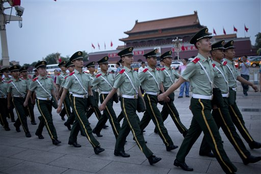 Paramilitary policemen march on Tiananmen Square after a flag-lowering ceremony on Tiananmen Square in Beijing, China, Wednesday, June 4, 2014. (AP Photo/Alexander F. Yuan)