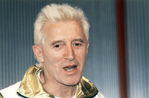 In this Dec. 17, 1986, file photo, Disc jockey and presenter on Britain's Radio 1, Jimmy Savile is pictured at Madame Tussauds museum in London, England. Investigators said the late BBC entertainer Jimmy Savile sexually assaulted victims aged from five to 75 in hospitals across Britain over more than four decades.  A series of reports released Thursday June 25, 2014 found that Savile, who had unsupervised access to multiple hospitals as a celebrity and a fundraiser, abused both patients and hospital workers. (AP Photo/John Redman, File)