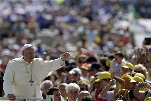 Pope Francis waves as he arrives in St. Peter's Square for his weekly general audience, at the Vatican, Wednesday, June 4, 2014. (AP Photo/Gregorio Borgia)
