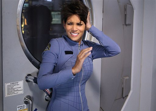 "This file image released by CBS shows Halle Berry in a scene from the series ""Extant."" The limited run series, in which Berry plays an astronaut who mysteriously returns from a solo space mission pregnant, had 9.6 million viewers for its first episode on CBS last week, the Nielsen company said. That was enough to make it the most-watched prime-time show during the week. (AP Photo/CBS, Sonja Flemming, File)"
