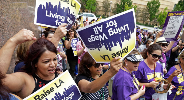 California's minimum wage rose to $10 an hour within three years under the bill, which was passed in September 2013. (AP Photo)