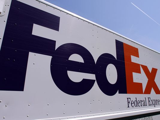 A FedEx delivery truck is seen at the Illinois State Capitol Wednesday, May 16, 2012 in Springfield, Ill. (AP Photo/Seth Perlman)