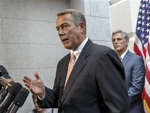 Speaker of the House John Boehner of Ohio, joined at right by incoming Majority Leader Rep. Kevin McCarthy of Calif., talks with reporters on Capitol Hill in Washington, Wednesday, July 23, 2014, following a Republican strategy session. House Republicans want to slash President Barack Obama's emergency spending request for the border, speed young migrants back home to Central America, and send in the National Guard.  (AP Photo/J. Scott Applewhite)