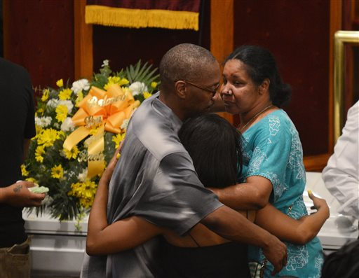 Esaw Garner, right, is consoled by family members at the funeral for her husband, Eric Garner, at Bethel Baptist Church in the Brooklyn borough of New York on Wednesday, July 23, 2014. Garner died in police custody after an officer placed him in an apparent chokehold. (AP Photo/New York Daily News, Julia Xanthos, Pool)