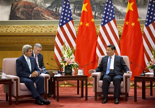 U.S. Secretary of State John Kerry, left, meets with Chinese President Xi Jinping, right, after attending the 6th U.S.-China Strategic and Economic Dialogue and 5th round of U.S. -China High Level consultation on People-to-people Exchange at the Great Hall of the People in Beijing, China Thursday, July 10, 2014. (AP Photo/Andy Wong, Pool)