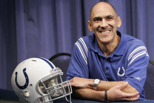 Indianapolis Colts head football coach Tony Dungy listens as team officials talk about the fact he will remain the team's coach at least through the 2008 season at a news conference in Indianapolis, Monday, Jan. 21, 2008. (AP Photo/AJ Mast)