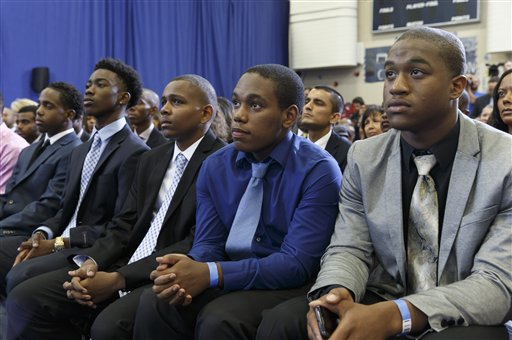 Young men listen intently as President Barack Obama speaks about the My Brother's Keeper Initiative, at the Walker Jones Education Campus in Washington, Monday, July 21, 2014. President Obama announced that leaders of 60 of the largest school systems have pledged to expand minority boys' access to better preschools and advanced classes and to try to prevent grade retention, suspensions and expulsions. (AP Photo/J. Scott Applewhite)
