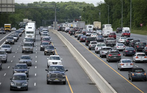 In this May 23, 2014 file photo, traffic moves on the Interstate 495, the Capital Beltway, in Hyattsville, Md., outside Washington. The Centers for Disease Control and Prevention released its latest drowsy driving report on Thursday, July 3, 2014. According to a new survey, about 1 in 25 adults say they recently fell asleep while driving. (AP Photo/Carolyn Kaster, File)