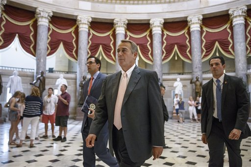 House Speaker John Boehner of Ohio strides to the House chamber  on Capitol Hill in Washington, Wednesday, July 30, 2014, as lawmakers prepare to move on legislation authorizing an election-year lawsuit against President Barack Obama that accuses him of exceeding his powers in enforcing his health care law. Democrats have branded the effort a political charade aimed at stirring up Republican voters for the fall congressional elections. They say it's also an effort by top Republicans to mollify conservatives who want Obama to be impeached — something Boehner said Tuesday he has no plans to do.  (AP Photo/J. Scott Applewhite)