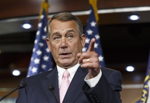"""In this July 24, 2014, file photo, House Speaker John Boehner, R-Ohio, talks with the media on Capitol Hill in Washington. While much of the rest of the world watches the Gaza war in horror and scrambles for a cease-fire, U.S. lawmakers are pressing the Obama administration to take no action that puts pressure on Israel to halt its military operations. Boehner said Monday, July 28, the administration should """"stand with Israel, not just as a broker or observer but as a strong partner."""" (AP Photo/File)"""