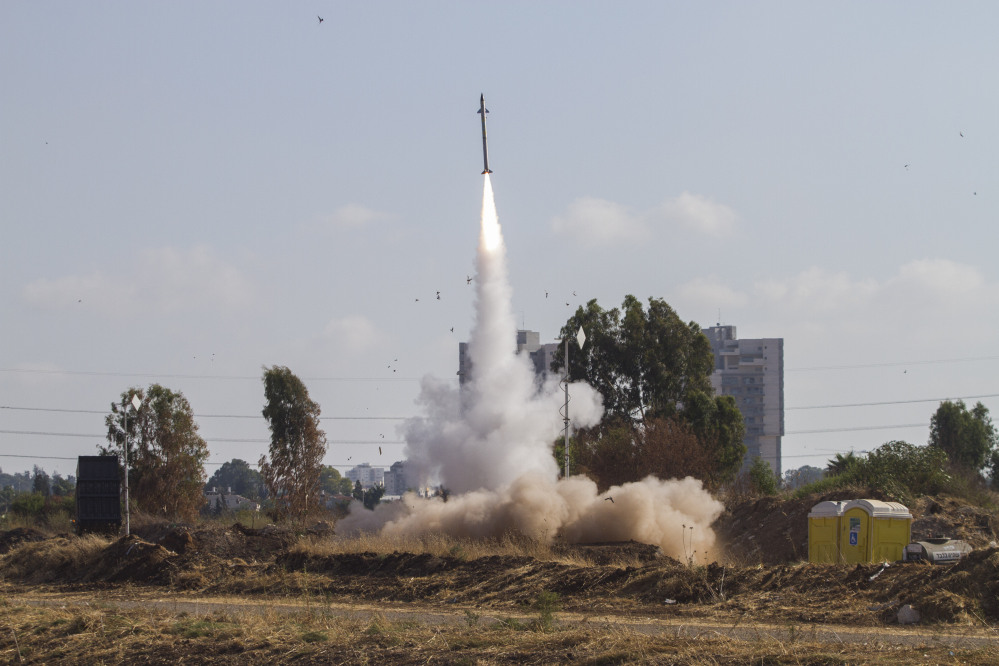 An Iron Dome air defense system fires to intercept a rocket from the Gaza Strip in Tel Aviv, Israel, on Wednesday, July 9, 2014 (AP Photo)