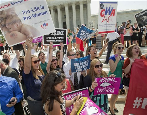 Demonstrator react to hearing the Supreme Court's decision on the Hobby Lobby case outside the Supreme Court in Washington, Monday, June 30, 2014. The Supreme Court says corporations can hold religious objections that allow them to opt out of the new health law requirement that they cover contraceptives for women. (AP Photo/Pablo Martinez Monsivais)