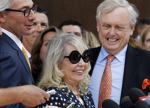With her attorney Pierce O'Donnell, right, Shelly Sterling, center, smiles as she talks to reporters after a judge ruled in her favor and against her estranged husband, Los Angeles Clippers owner Donald Sterling, in his attempt to block the $2 billion sale of the NBA basketball team, outside Los Angeles Superior Court Monday, July 28, 2014. (AP Photo/Nick Ut)