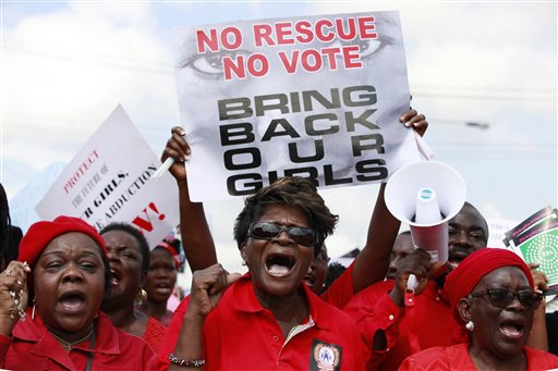In this Monday, May 5, 2014 file photo, women attend a demonstration calling on the government to rescue kidnapped school girls of a government secondary school in Chibok, Nigeria, in Lagos. (AP Photo/Sunday Alamba, File)
