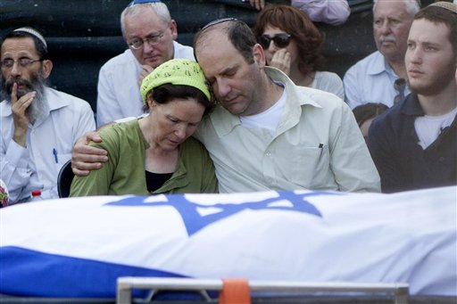 Avi and Rachel Fraenkel embrace during the funeral of their son, Naftali, a 16-year-old with dual Israeli-American citizenship, in the West Bank Jewish settlement of Nof Ayalon, Tuesday, July 1, 2014. The Israeli military found the bodies of three missing teenagers just over two weeks after they were abducted in the West Bank — a grim discovery that ended a frantic search that led to Israel's largest ground operation in the Palestinian territory in nearly a decade and drew Israeli threats of retaliation. (AP Photo/Tomer Appelbaum)