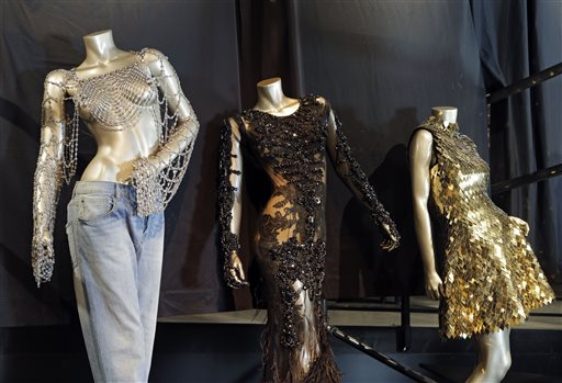 "In this Thursday, July 17, 2014 photo, from left, outfits from Beyonce's 2003 ""Dangerously in Love,"" 2012 ""Met Gala"" and 2011 ""Run the World (Girls)"" are shown in a new exhibit at the Rock and Roll Hall of Fame in Cleveland. The Rock Hall announced Friday, July 18, 2014, that outfits from Beyonce's Super Bowl performance and music videos will debut Tuesday in the Ahmet Ertegun Main Exhibit Hall in its Legends of Rock section next to iconic pieces from Michael Jackson, David Bowie and Bruce Springsteen. (AP Photo/Mark Duncan)"