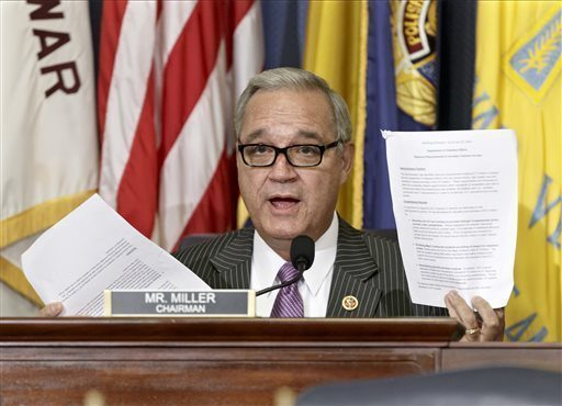 In this July 24, 2014, file photo, House Veterans Affairs Committee Chairman Jeff Miller, R-Fla., holds up two pages of resource requests from the Department of Veterans Affairs on Capitol Hill in Washington. (AP Photo/File)