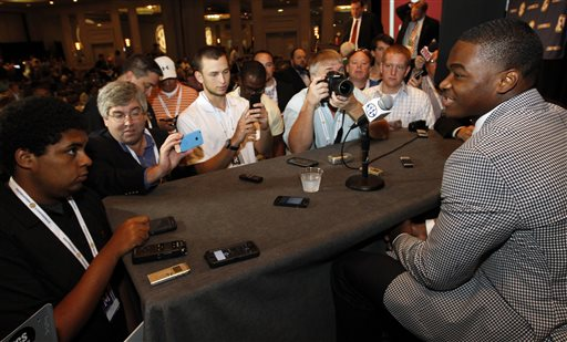 Alabama wide receiver Amari Cooper speaks to the media at the Southeastern Conference NCAA college football media days Thursday, July 17, 2014, in Hoover, Ala. (AP Photo/Butch Dill)
