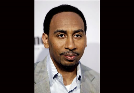 In this Saturday, Dec. 12, 2009 file photo, Stephen A. Smith arrives at Spike TV's Video Game Awards in Los Angeles. ESPN says it has suspended sportscaster Stephen A. Smith, Tuesday, July 29, 2014 for a week because of comments about domestic abuse suggesting women should make sure they don't provoke attacks.  (AP Photo/Matt Sayles, File)