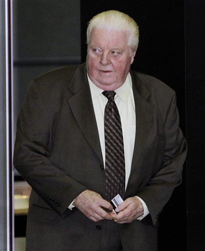 In this June 8, 2010 file photo, former Chicago Police Lt. Jon Burge arrives at the federal building for his obstruction of justice and perjury trial in Chicago. Burge was convicted in 2010 and is now imprisoned of lying about the torture of suspects decades ago. On Thursday, July 3, 2014, the Illinois Supreme Court ruled that Attorney General Lisa Madigan can't challenge a police pension board vote preserving pension payments to the former Chicago police commander. (AP Photo/Charles Rex Arbogast, File)
