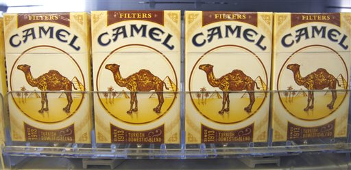 In this photo April 20, 2011, file photo, Camel brand filters cigarettes from Reynolds American Inc., are displayed at a tobacco product store in Cranberry, Pa. Cigarette makers Reynolds American Inc. and Lorillard Inc. say they are in talks of a possible merger that would combine two of the nation's biggest tobacco companies. (AP Photo/Keith Srakocic, File)