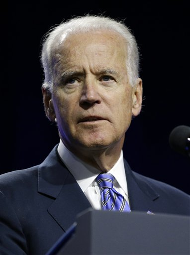 """Vice President Joe Biden speaks on voting rights at the NAACP annual convention Wednesday, July 23, 2014, in Las Vegas. Biden called on members of the NAACP to spread the word about what he called """"a hailstorm"""" of measures to restrict citizens' ability to vote, trying to rally the Democratic Party's base before the midterm elections. (AP Photo/John Locher)"""