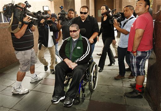 FILE - This June 25, 2014 file photo shows a wheelchair bound Bryan Stow surrounded by family and media as he is led into the Los Angeles County Superior Courthouse in Los Angeles. Stow has won his negligence suit against the Los Angeles Dodgers, but former owner Frank McCourt has been absolved by the jury.(AP Photo/Los Angeles Times, Al Seib,File) NO FORNS; NO SALES; MAGS OUT; ORANGE COUNTY REGISTER OUT; LOS ANGELES DAILY NEWS OUT; INLAND VALLEY DAILY BULLETIN OUT; MANDATORY CREDIT, TV OUT