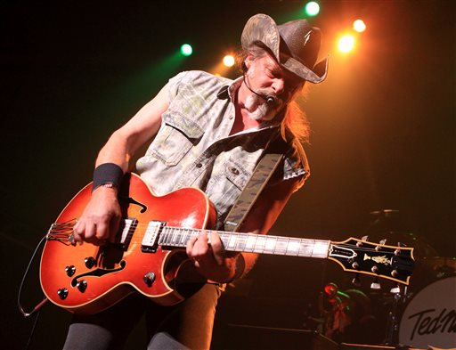 "This Aug. 16, 2013 file photo shows Ted Nugent performing at Rams Head Live in Baltimore. A Native American tribe has canceled an Aug. 4, 2014, concert by Nugent at its casino. The Coeur d'Alene Tribe on Monday, July 21, 2014, said that the cancellation of the concert at the casino in Worley was because of what it called the rocker's ""racist and hate-filled remarks.'' (Photo by Owen Sweeney/Invision/AP, File)"