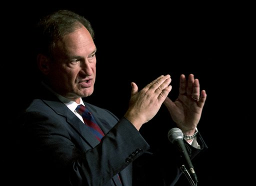 "This Feb. 3, 2014, file photo shows Supreme Court Justice Samuel Alito speaking in West Palm Beach, Fla. There may be more to that ""we the people"" notion than you thought.These are boom times for the concept of ""corporate personhood."" Corporations are people? Mitt Romney got mocked during the 2012 presidential campaign for the very idea. But it turns out the principle has been lurking in U.S. law for more than a century, and the Supreme Court, in a 5-4 ruling, gave it more oomph this week when it ruled that certain businesses are entitled to exercise religious rights just as do people. (AP Photo/Wilfredo Lee, File)"