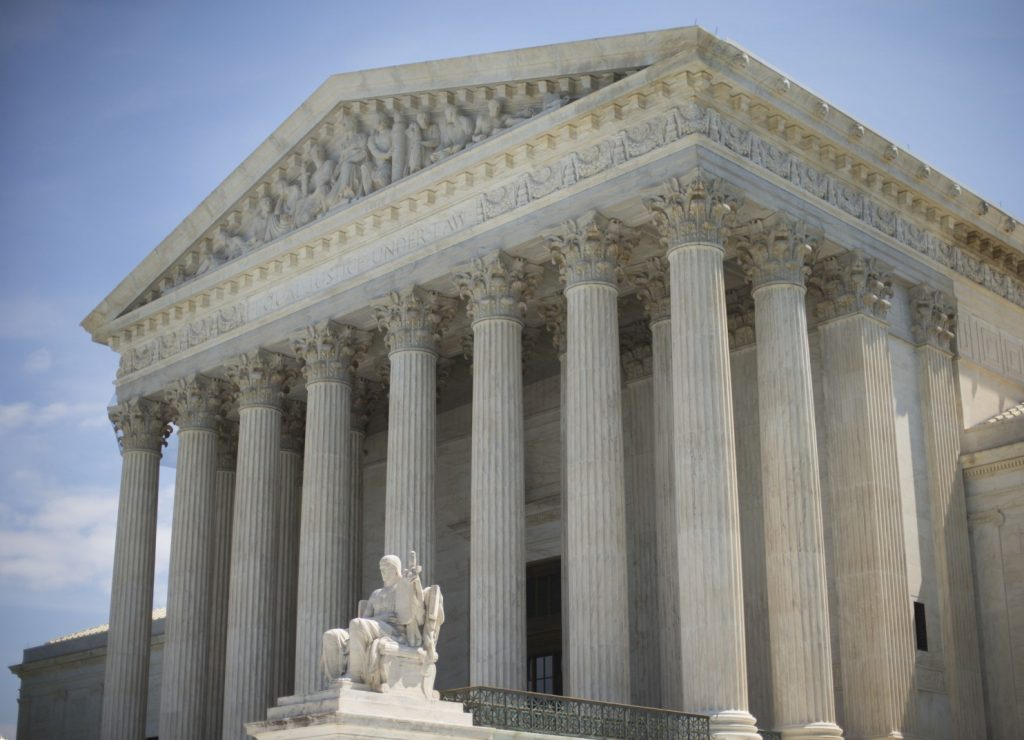 The Supreme Court in Washington. The three female justices say their colleagues are reversing themselves from this week's Hobby Lobby ruling. (Pablo Martinez Monsivais/AP)