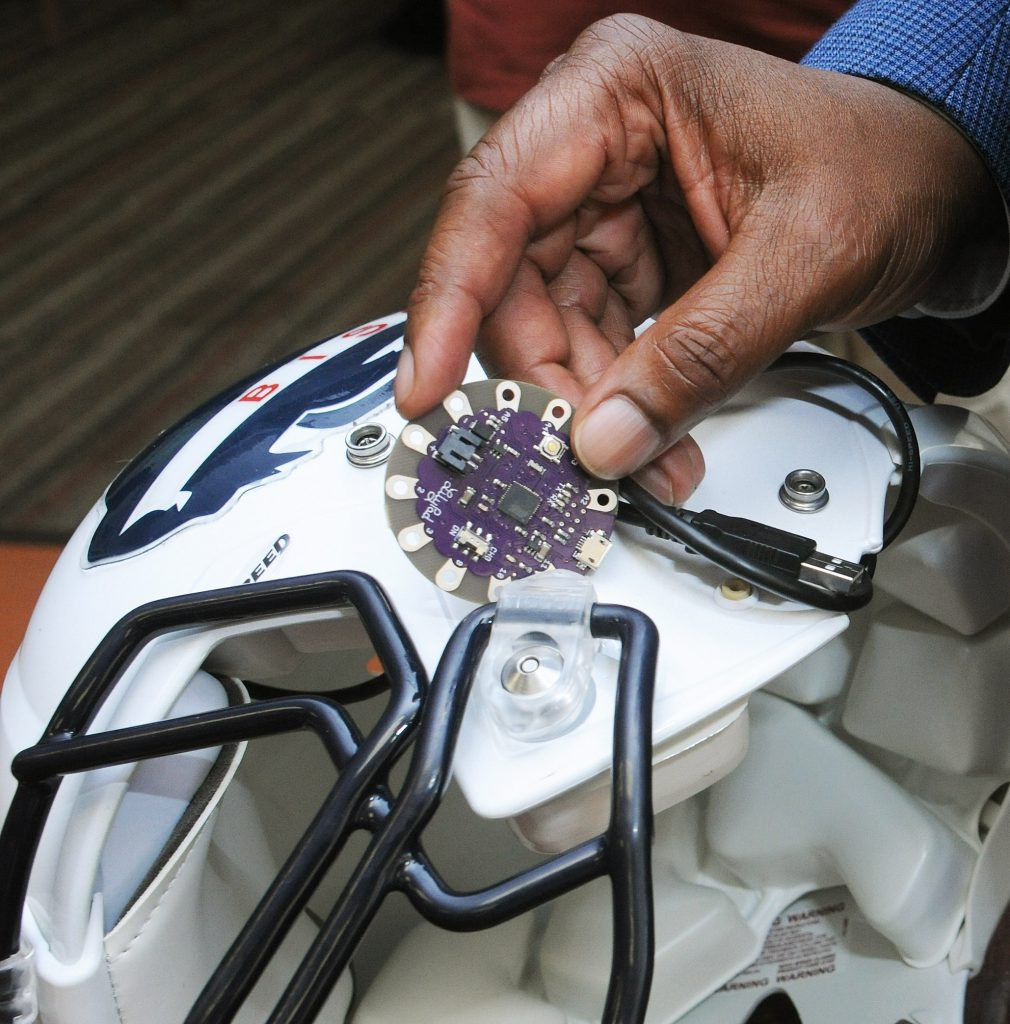 """Dr. Gary Harris hopes to improve the way the Howard University Bison football team combats concussion, using this """"Lilypad"""" Arduino chip to measure impact during games. (Photo courtesy of Howard University)"""