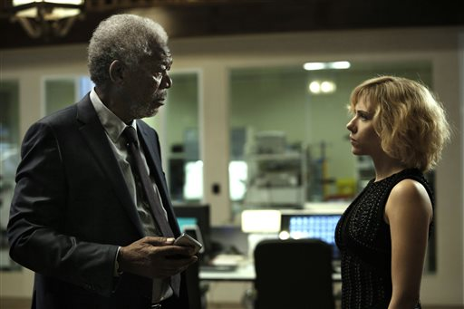 "This image released by Universal Pictures shows Morgan Freeman, left, and Scarlett Johansson in a scene from ""Lucy."" (AP Photo/Universal Pictures, Jessica Forde)"