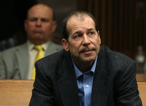 In this April 25, 2014, file photo, Theodore Wafer listens during a motion hearing in Judge Timothy Kenny's courtroom at the Frank Murphy Hall of Justice in Detroit. Jury selection starts Monday, July 21, 2014, in a trial that will put Wafer's self-defense claim to a tough test. The 19-year-old woman, Renisha McBride, was drunk but unarmed when she climbed the steps of his Dearborn Heights porch, 3 ½ hours after crashing her car a few blocks away. Roused from sleep by the sound of pounding in the wee hours, he grabbed his shotgun, opened the front door and blasted her in the face. (AP Photo/Detroit Free Press, Eric Seals, File)