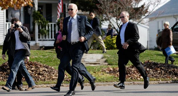Biden runs across the street from a campaign stop to meet students outside two schools in Muscatine, Iowa. (AP Photo)