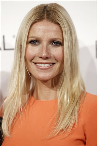 In this Oct. 18, 2010, file photo, actress Gwyneth Paltrow arrives at a ELLE magazine's 17th Annual Women in Hollywood Tribute in Beverly Hills, Calif. Paltrow and Joel Gallen are returning to produce 'Stand Up to Cancer' for a second time and other stars from TV, film and music will encourage and accept donations from the public. The money raised supports cross-disciplinary research toward new cancer treatments. (AP Photo/Matt Sayles, File)