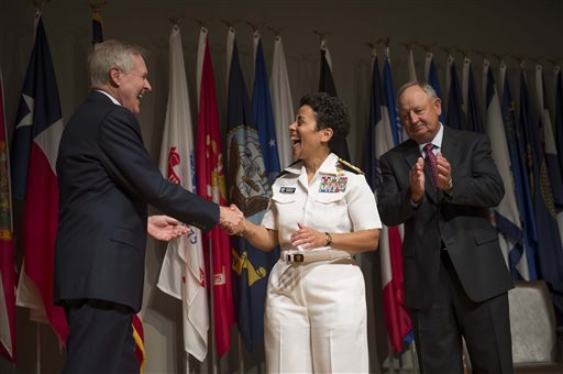 Secretary of the Navy Ray Mabus,left, congratulates Adm. Michelle Howard after putting on her fourth star during her promotion ceremony at the Women in Military Service for America Memorial in Washington Tuesday July 1, 2014. Howard is the first woman to be promoted to the rank of admiral in the history of the Navy and will assume the duties and responsibilities as the 38th Vice Chief of Naval Operations from Adm. Mark Ferguson. Howard's husband Wayne Cowles is at right.  (AP Photo/ Chief Mass Communication Specialist Peter D. Lawlor)