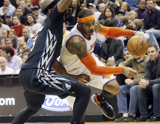 In this March 5, 2014, file photo, New York Knicks' Carmelo Anthony, right, leaves the floor as he drives around Minnesota Timberwolves' Dante Cunningham in the second half of an NBA basketball game in Minneapolis. A person with knowledge of the plans says the Knicks plan to meet with Anthony on Thursday, July 3, 2014, in Los Angeles. Anthony was in Los Angeles to meet with the Lakers, who are among the teams hoping to convince the All-Star forward to leave New York. (AP Photo/Jim Mone, File)