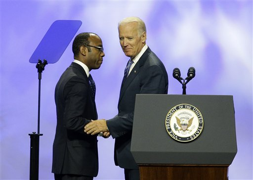 "Vice President Joe Biden, right, shakes hands with NAACP President and CEO Cornell William Brooks at the NAACP annual convention Wednesday, July 23, 2014, in Las Vegas. Biden called on members of the NAACP to spread the word about what he called ""a hailstorm"" of measures to restrict citizens' ability to vote, trying to rally the Democratic Party''s base before the midterm elections. (AP Photo/John Locher)"