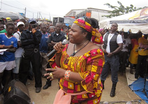 In this photo taken on July 8, 2014, Ebola advocacy group Crusaders for Peace, spokesperson Juli Endee, center, educates people on the deadly virus in Paynesville, east of the city Monrovia, Liberia. (AP Photo/Jonathan Paye-Layleh)