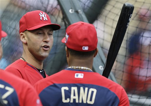 American League shortstop Derek Jeter, of the New York Yankees, left, talks with teammate second baseman Robinson Cano, of the Seattle Mariners, during batting practice for the MLB All-Star baseball game, Monday, July 14, 2014, in Minneapolis. (AP Photo/Jeff Roberson)