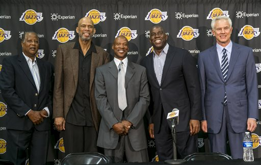 "Former Los Angeles Lakers players from left, Jamaal Wilkes, Kareem Abdul-Jabbar, Byron Scott, Earvin ""Magic"" Johnson with general manager Mitch Kupchak pose during a news conference to introduce Scott as the new Lakers head coach in Los Angeles Tuesday, July 29, 2014.  Scott is the former head coach for New Jersey, New Orleans and Cleveland, reaching two NBA Finals with the Nets. He was the NBA's coach of the year in 2008. (AP Photo/Damian Dovarganes)"