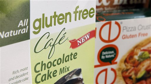 """In this Aug. 2, 2013, file photo, a variety of foods labeled Gluten Free are displayed in Frederick, Md., Friday, Aug. 2, 2013. Starting this week, """"gluten free"""" labels on packaged foods have real meaning. Until now, the term """"gluten free"""" had not been regulated, and manufacturers made their own decisions about what it means. (AP Photo/Jon Elswick, File)"""