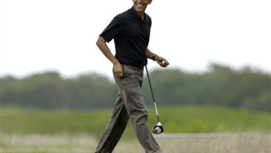 Photo of Obama Interrupting Summer Vacation with Trip to DC