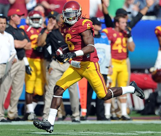 "FILE - In this Oct. 26, 2013, file photo, Southern California safety Josh Shaw recovers a Utah fumble in an NCAA college football game in Los Angeles. Shaw confessed that he lied to school officials about how he sprained his ankles last weekend, retracting his story about jumping off a balcony to save his drowning nephew. The school swiftly suspended him from all football team activities Wednesday, Aug. 27, 2014, and acknowledged his heroic tale was ""a complete fabrication."" (AP Photo/Pasadena Star-News, Keith Birmingham, File)"
