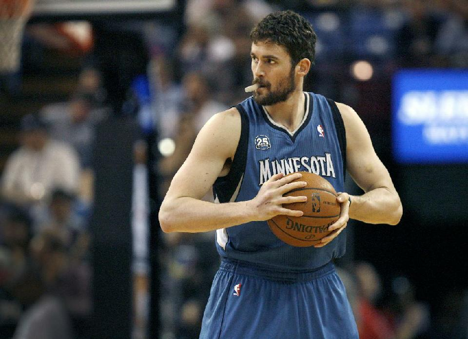 In this April 13, 2014, file photo, Minnesota Timberwolves forward Kevin Love gets ready to play the Sacramento Kings in Sacramento, Calif. A person with knowledge of the situation tells The Associated Press that the Timberwolves and Golden State Warriors have restarted trade talks for All-Star forward Kevin Love. (AP Photo/Steve Yeater, File)