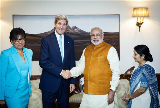 U.S. Secretary of State John Kerry shakes hands with Indian Prime Minister Narendra Modi, as Indian Foreign Minister Sushma Swaraj, right, and U.S. Secretary of Commerce Penny Pritzker stand by their sides at Modi's residence in New Delhi, India, Friday, Aug. 1, 2014. Kerry is on a three-day visit, his first following the resounding election win of Modi in May. (AP Photo/Lucas Jackson, Pool)