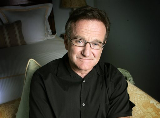This June 15, 2007 file photo shows actor and comedian Robin Williams posing for a photo in Santa Monica, Calif. Williams, whose free-form comedy and adept impressions dazzled audiences for decades, died Monday, Aug. 11, 2014, in an apparent suicide. Williams was 63.  (AP Photo/Reed Saxon, File)