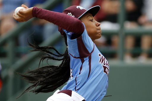 Pennsylvania's Mo'ne Davis delivers in the fifth inning against Tennessee during a baseball game in U.S. pool play at the Little League World Series tournament in South Williamsport, Pa., Friday, Aug. 15, 2014. Pennsylvania won 4-0 with Davis pitching a two-hitter. AP Photo/Gene J. Puskar)