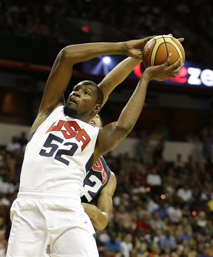 Oklahoma City Thunder's Kevin Durant (52) goes up for a dunk against New Orleans Pelicans' Anthony Davis (42) during the U.S. national team's instrasquad exhibition basketball game Friday, Aug. 1, 2014, in Las Vegas. (AP Photo/John Locher)