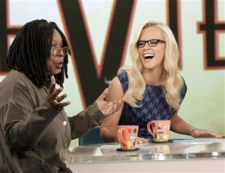 """This image released by ABC shows co-hosts Whoopi Goldberg, left, and Jenny McCarthy during a broadcast of """"The View,"""" Monday, Sept. 9, 2013 in New York. (AP Photo/ABC, Lou Rocco)"""